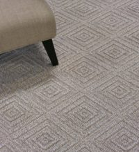 Bellbridge Inca Multi-Mix color Taupe 5202M/102 shown chair used a prop. Inca Multi-Mix is a loop wilton comprised of several colored heathered yarns (taupe,beige,creme) woven to create a textural diamond design.
