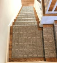 Stair runner using Bellbridge Leighton Mink 750/1522. Leighton is an elongated grid design created by two dominant colors. Fabricated/installed by Carpet Works.