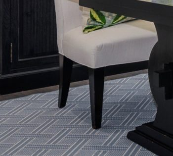 Bellbridge Brisa Lt Denim 17/5740 featured in room setting of new build in Orinda, CA. Brisa is an open basketweave design. Image shows dining room with Brisa Lt Denim as floor covering. Various pieces of furnishings and decor are throughout the room.