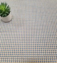 Bellbridge Ainsley 5760/7 shown with plant. Three different colored yarns (med blue, med camel and natural white) woven across the warp and weft create the small grid design and texture.