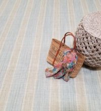 """Bellbridge Linen Stripe Aqua Sand 370F / 5703F showing tote and basket as props. This colorway is available in 15'9"""" width."""